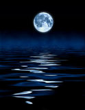 Blue Moon Ocean. Blue moon and mist over ocean composite abstract stock photography