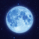 Blue moon with star at night sky. Full blue moon with star at dark night sky background Royalty Free Stock Image