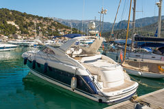 A blue moored motorboat Royalty Free Stock Images