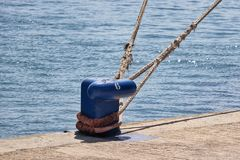Blue mooring post on quay side royalty free stock photo