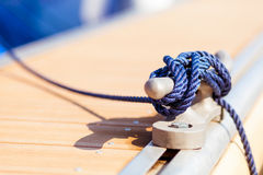 Blue mooring rope on ship. Closeup of blue mooring rope tied around anchor on boat or ship royalty free stock images