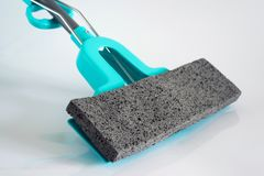 Blue mop for washing the floor on light background Royalty Free Stock Photography