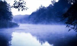 Blue morning fog on a calm river Royalty Free Stock Photos