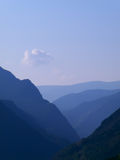 Blue morning between mountains Royalty Free Stock Photos