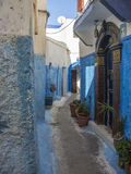 The blue Moroccan street à rabat. Here is one of the narrow streets of the Ouadaïas Rabbah Casbah. Its small alleys with its limed houses all painted in blue Royalty Free Stock Photos
