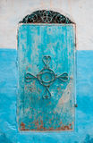 Blue Moroccan Style Door. A turquoise door in a village in Chefchouaen, Morocco, North Africa Stock Photo