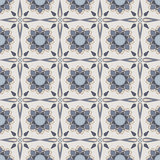 Blue mosaic flowers. Blue geometric flowers and stars on light grey background Stock Photography