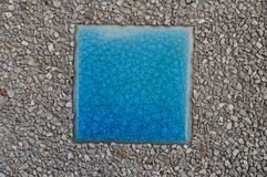 Blue mosaic inserted between arenaceous rock. Stock Photos