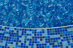 Blue mosaic in the pool. The photo of pool with water covered with blue mosaic Stock Photos