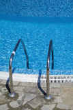 Blue mosaic in the pool. The photo of pool with water covered with blue mosaic Royalty Free Stock Photo