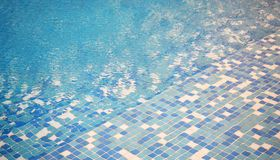 Blue mosaic swimming pool background Royalty Free Stock Image