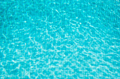 Blue mosaic swimming pool with clear water. Background. Royalty Free Stock Photo