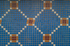Blue mosaic tile. Old blue mosaic with square pattern made of blue, white and orange tiles, placed on outdoor wall of old building in Konya, Turkey Stock Photos