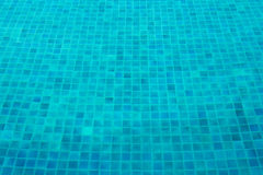 Blue mosaic tiles of swimming pool. Blue mosaic tiles on the ground of swimming pool Stock Photo