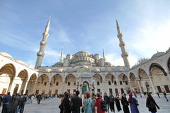 Blue mosque. ISTANBUL, TURKEY - December 08: Tourists in the courtyard of Sultanahmet Mosque on December 08, 2012 in Istanbul, Turkey. This is the biggest mosque Royalty Free Stock Photography