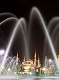 Blue Mosque. Night shot of the Blue Mosque taken through the fountain royalty free stock photo
