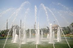 Blue Mosque through fountains stock image