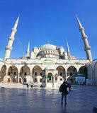 Blue Mosque Sultanahmet ant its Courtyard. Blue Mosque front view with its courtyard where people can wisit royalty free stock image
