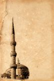 Blue Mosque in Istanbul. Minaret and dome of Blue Mosque in Istanbul, Turkey. Effect of old photo using old torn paper. Vertical version royalty free stock photography