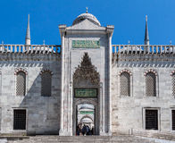Blue Mosque Istanbul Turkey. The Blue Mosque (Sultan Ahmed Mosque) entrance, two minarets and some arabic writing, Istanbul, Turkey Royalty Free Stock Photography