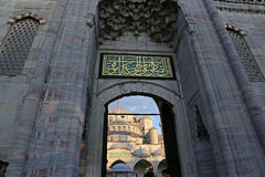 Blue Mosque Main Gate. The Blue Mosque, shot through it's main gate.  Located in Istanbul, Turkey.  It was completed in 1616 by Sultan Ahmed I Stock Photos