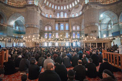 Blue mosque. People sit in Blue Mosque waiting for pray Royalty Free Stock Photos
