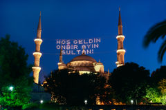 Blue Mosque in Ramadan in Istanbul,Turkey. Welcome to the sultan of eleven months lettering hanging on Blue Mosque's mahya in Istanbul,Turkey.Mahya is an
