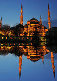 Blue mosque reflexion. The famous Istanbul mosque known as the Blue Mosque reflected in a blue lake in the evening Stock Images
