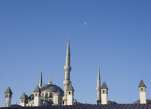 Blue Mosque Roof with the moon and a clear sky Royalty Free Stock Photo