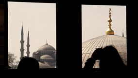 Blue mosque seen trough a window from Santa Sofia Royalty Free Stock Photo