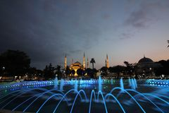 Blue mosque at sunset and the beatiful fountain stock images