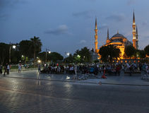 Blue Mosque and Tourists. ISTANBUL, TURKEY - AUGUST 08, 2015: The Blue Mosque illuminated after sunset.  Located in Istanbul, Turkey.  It was completed in 1616 Stock Photo