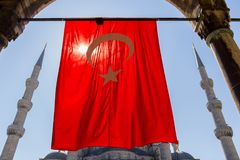 Blue Mosque with Turkish flag view from arch. April 27, 2013. Istanbul, Turkey Stock Photography