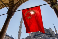 Blue Mosque with Turkish flag view from arch. April 27, 2013. Istanbul, Turkey Stock Images