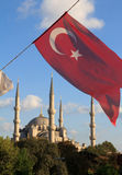 Blue Mosque Turkish flags view from M. Arkif Ersoy Sultanahment Stock Image