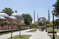 Blue Mosque and walking people in Sultan Ahmet Park, Istanbul, T Stock Images