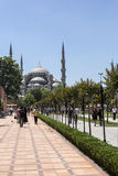 Blue Mosque and walking people in Sultan Ahmet Park, Istanbul, T Royalty Free Stock Photos