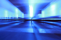 Blue motion. White lights blurred on a blue background Royalty Free Stock Photos