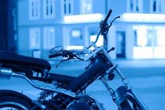 Blue moto bike in Tromso background Royalty Free Stock Photos