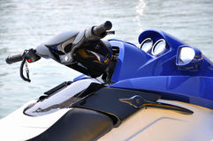A blue motor boat. Stop beside water, shown as water sport or holiday and entertainment Royalty Free Stock Images