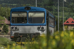 Blue motor train in Stare Mesto pod Sneznikem station. In spring sunny day Royalty Free Stock Image