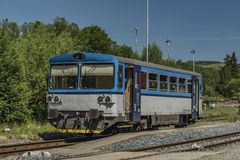 Blue motor train in Stare Mesto pod Sneznikem station. In spring sunny day Royalty Free Stock Images