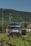 Blue motor train in Stare Mesto pod Sneznikem station. In spring sunny day Stock Photos
