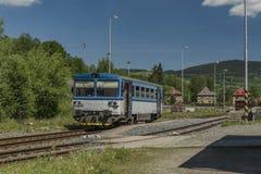 Blue motor train in Stare Mesto pod Sneznikem station. In spring sunny day Royalty Free Stock Photo