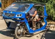 Blue motor-tricycle taxi in Puerto Princesa, Palawan, Philippines