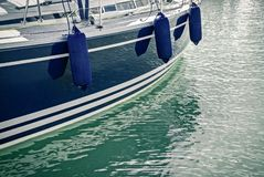 Blue motorboat reflecting in water royalty free stock photos