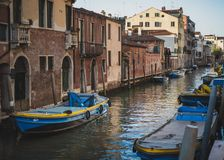 Blue boats on the Venetian Canal royalty free stock image