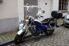 Blue motorcycle in the city; Stock Image
