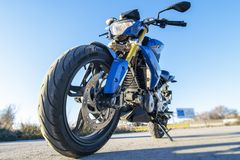 Blue motorcycle on the road contrapicado view. stock photos
