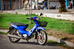Blue motorcycle at road of Sitia town on Crete island Royalty Free Stock Photography